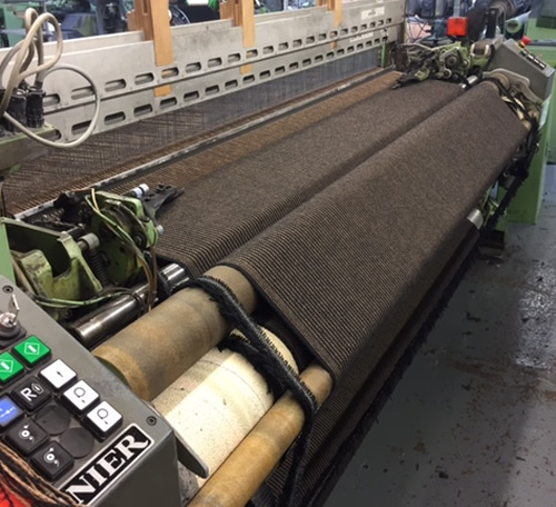 weaving twool cloth on a loom